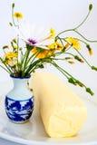 Butter mit Wildflowers Stockfotografie