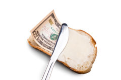 Butter and money on a slice of bread. And knife Stock Images