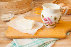 Butter on parchment and milk in jug royalty free stock images
