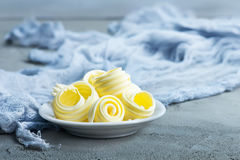 Butter. On plate and on a table Stock Images