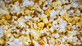 Butter popcorn. A close up of popcorn, many corn grains pop it out covered whit butter and salt, cinema snack, cooked corn texture background stock photography