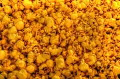 Butter Popcorn. A Pile of fresh buttery popcorn shot in studio Stock Image