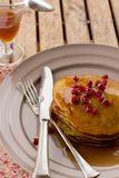 Butter pumpkin pancakes with jelly and pomegranate Royalty Free Stock Images