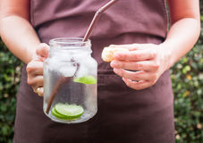 Butter scone and lime Infused detox water Stock Photo