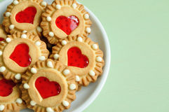 Butter shortbread cookies with red jelly in the form of hearts Stock Image