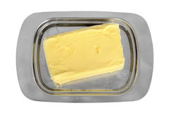 Butter on silver butter dish Royalty Free Stock Photography