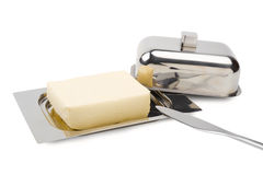 Butter on silver butter dish, knife, isolated Royalty Free Stock Images