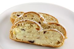 Butter on a  slice of Christmas stollen cake Royalty Free Stock Images