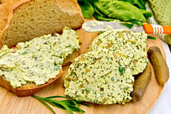 Butter with spinach and bread on board Royalty Free Stock Photo