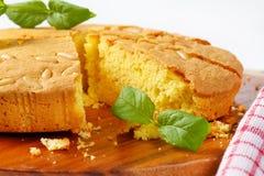 Butter sponge cake. Slices of butter sponge cake on a cutting board Stock Image
