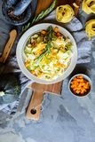 Butter squash pasta salad with zucchini slices, cheddar cheese and scallion royalty free stock photos