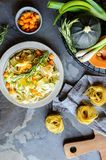 Butter squash pasta salad with zucchini slices, cheddar cheese and scallion royalty free stock photography