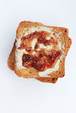 Butter and strawberry jam on toast Stock Photos