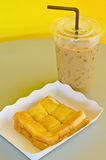 Butter and sugar toast with ice coffee Royalty Free Stock Photo