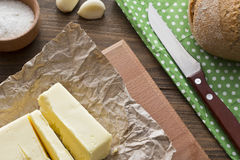 Butter on the table. Next to the knife top view Stock Photos