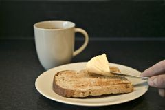 Butter on toast Stock Photo