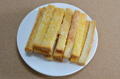 Butter toasted bread topping sugar on dish Stock Photos