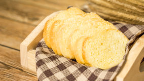 Butter toasted bread topping sugar on wood tray Royalty Free Stock Images
