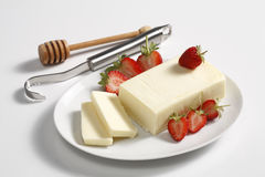 Butter,strawberries and curler Stock Photography