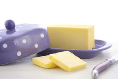 Butter on white wood table. Stock Image