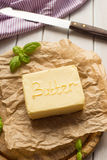 Butter on the wooden plate. dairy products. Royalty Free Stock Image