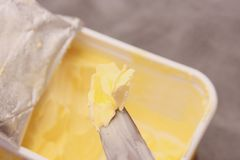 Butter. Yellow butter on silver knife Royalty Free Stock Photography