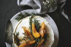 Buttercream cake with apricot and rosemary royalty free stock photography