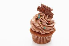 Buttercream chocolate cupcake with chocolate sticker Royalty Free Stock Photos