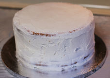 Buttercream Crumb coat on a cake Royalty Free Stock Images
