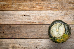 Buttercup winter squash on wood Royalty Free Stock Photo