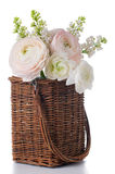 Buttercups and white lilac in a wicker basket Stock Images