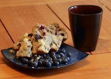 Buttered berry muffin. On a wood table with coffee and blueberries for breakfast or brunch Stock Photography