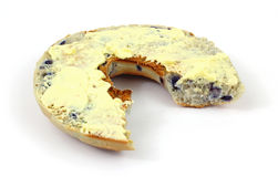 Buttered blueberry bagel that has been bitten Royalty Free Stock Photography