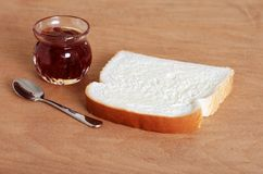 Buttered bread with jam pot Royalty Free Stock Photos