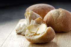 Buttered Bread Roll. Lovely and crusty, ready to eat Stock Photography