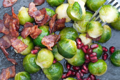 Buttered Brussels Sprouts. Pan buttered brussels sprouts with crispy bacon and pomegranate Stock Photography