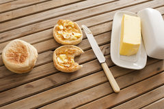 Buttered crumpets with a pat of farm butter Royalty Free Stock Photo