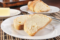 Buttered french bread Stock Images