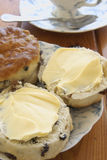 Buttered fruit scones. And afternoon tea Stock Images