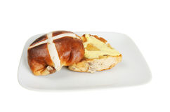 Buttered hot cross bun Royalty Free Stock Image