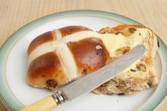 Buttered hot cross bun Stock Photography