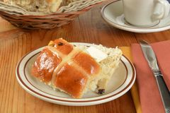 Buttered hot cross bun Royalty Free Stock Images