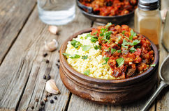 Buttered millet with tomato eggplant curry Royalty Free Stock Photography