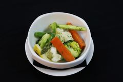 Buttered mix vegetables in a bowl stock photography