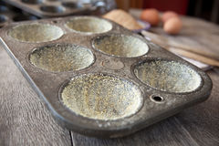 Buttered muffin tin with corn flour Royalty Free Stock Photos