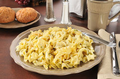 Buttered Noodles. A plate of buttered noodles with dinner rolls Royalty Free Stock Photography