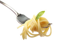 Buttered pasta with basil on a fork