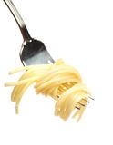Buttered pasta on a fork. Cleanly isolated plain pasta swirled onto a fork Stock Photos
