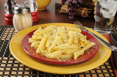 Buttered penne rigate noodles with Parmesan cheese Stock Photo