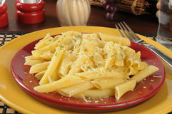 Buttered penne rigate noodles with parmesan cheese Stock Images